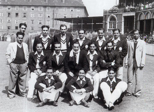 Chandu Sarwate is siting the center on the ground in this group photo of India's tour to England in 1946