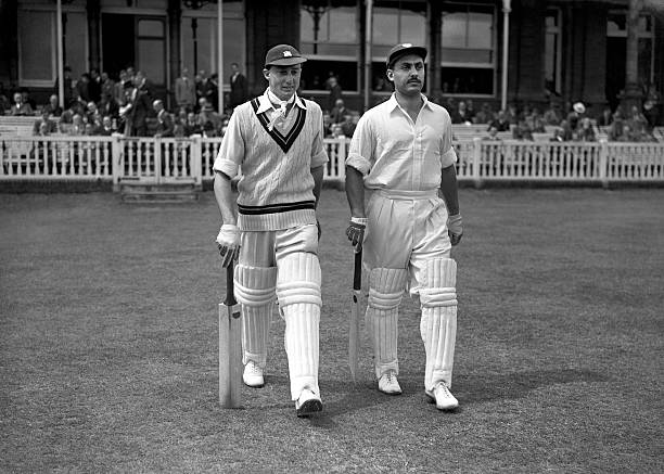 Allan Rae (l) and Jeffrey Stollmeyer (r) make their way to the crease to open the innings for the West Indies (Photo by S&G/PA Images via Getty Images)