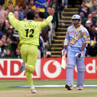 India's opening batsman Sadagopan Ramesh (R) is out off the bowling of Pakistan's Abdur Razzaq 08 June 1999, during the Cricket World Cup match at Old Trafford, Manchester. The final will be at Lords on the 20 June 99. (ELECTRONIC IMAGE)