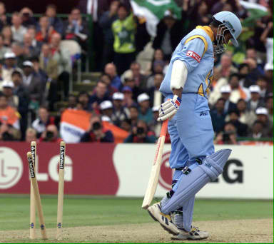 Sadagopan Ramesh of India walks away from the wicket after being bowled out at Old Trafford 08 June 1999 during the super six match of the Cricket World Cup match in Manchester.