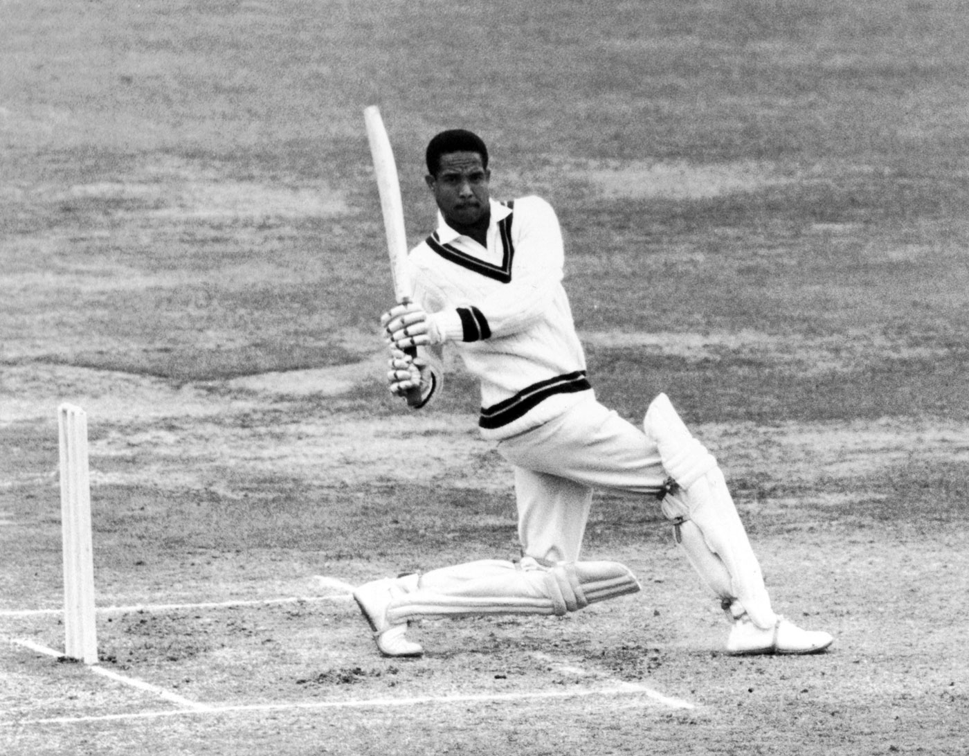 Garry Sobers minimal foot movement, great follow-through, the ball ricocheting off the boundary boards as not a man moved.