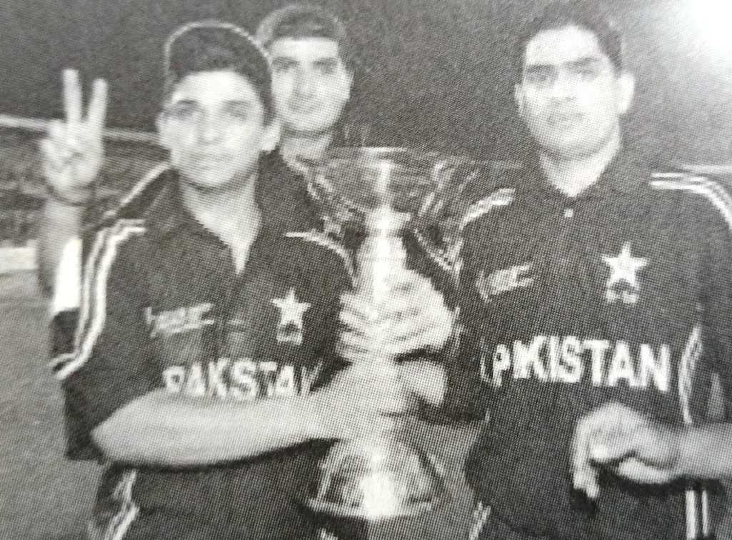 Skipper Khalid Latif holds the trophy, with Riaz Afridi in the background and Asif Iqbal on the Right Side.