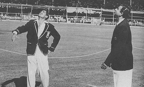 Abdul Hafeez Kardar along with the Indian captain await the coin verdict,